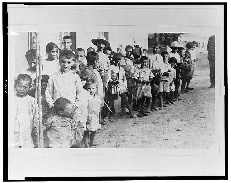 754px Greek and Armenian refugee children from Anatolia standing outside one story building near Athens Greece LCCN2002709161